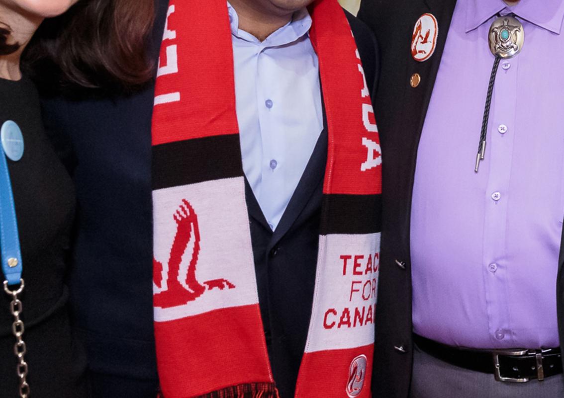 Man wearing Teach for Canada scarf